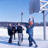 Children playing basketball at the Soldotna Elementary playground, Soldotna 1967